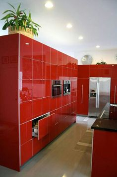 Modern, contemporary red kitchen: cool but I don't think I'd do it.