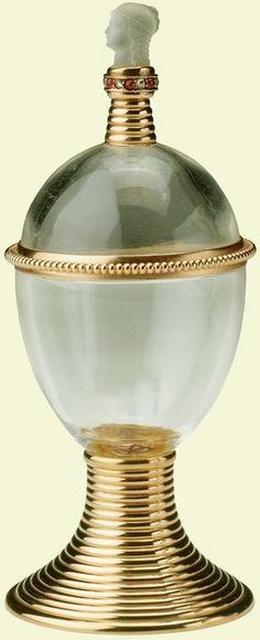 A rock-crystal, gold, diamond, ruby and moonstone egg-shaped cup by Erik August Kollin for Fabergé, 1901; the finial is in the form of Minerva's head; 'The foot is enamelled with the letters 'X.B' for 'Christoss Voskress' ('Christ is risen'). The cup was specifically intended to be used for the traditional presentation of an egg on Easter morning'. (Royal Collection Trust)