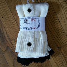 New lace and button knit leg warmer one size Beautiful knit white leg warmers. These have pretty black lace design at the top and buttons all the way down the side. Super cute and warm. Perfect to throw on with boots. New with tags. - willing to negotiate price through offer button -  - No trades / No paypal -  - bundle discounts - Boutique  Accessories Hosiery & Socks