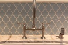 Adore this moroccan tile backsplash! Love the shape, color and contrasting grout.