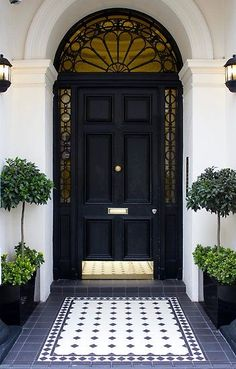 Dream house exterior - how cute is this front entry? Black front door is so classic and dramatic. Add a polished brass hardware package and kick plate, really make it POP with oversized planters, a monogrammed door decal, and area rug tile pattern. House Design, Front Door Design, Entrance Doors, Front Door, Front Door Entrance, Entrance, Black Doors, Doors, House Exterior