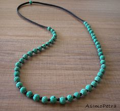 This handmade necklace is made of lava, black agate beads and hand knotted macrame.