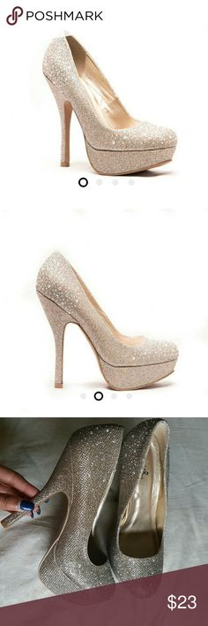 Champagne Glitter Heels Gorgeous champagne colored glitter heels with little florescent rhinestones. Perfect for any special occasion! Worn once for like two hours in great condition. There is a little light mark on back of the right  heel but I received them that way & a very small scuff mark on bottom back of the left heel. Box included. Any questions or additional pictures needed feel free to ask! Qupid Shoes Heels