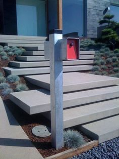 Floating Concrete stairs. love the modern mailbox too