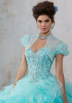 Organza Quinceañera Dress with Jewel Beaded Sweetheart Bodice. Ruffled Ombre Skirt. Matching Bolero Jacket. Colors Available: Champagne/Blush, Light Aqua/Mint, White.