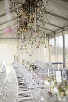 Gorgeous wedding decoration with flowers hung from ceiling - Wedding reception for an outdoor rustic wedding   Photo by Blumenthal Photography   Read this real wedding on I take you - UK wedding blog