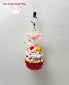 Pinky bow creamy fruity polymer clay cupcake phone charm. I wish I was as talented as Carmen Ferreira. She is the person who posted this idea.