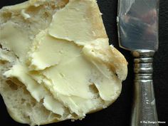 Homemade Butter (NOT cheaper than store bought…but…it's cool and fun, and it tastes great.  Also, I guess you COULD churn it by hand, but this how-to uses a kitchenaid mixer…and that's just fine by me)
