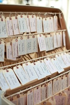 luggage tag escort cards... in a suitcase! Perfect for our train station reception!