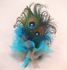 Peacock Feather Flower Corsage with guinea, ostrich, rooster and other coordinating feathers and ribbon. $31.00, via Etsy.
