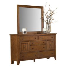 Add a country-chic touch to your master suite or guest room with this  rubberwood dresser, showcasing 8 drawers and a rustic oak finish.   ...