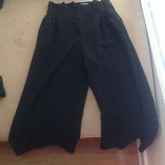 Wide legged black trouser. I love these pants I used to live in them! They are a size 12 but they run a little small. They are snitched at the waist and have a flares leg. silence + noise Pants Trousers