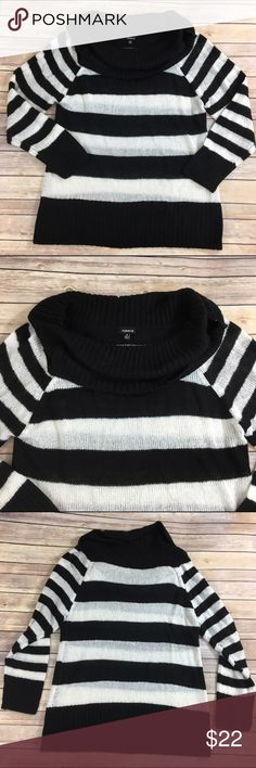 Torrid black and white stripe sweater Black and white striped Loose Knit sweater by torrid. Good condition. Measures about 45 inches around the bust and is about 30 inches long. torrid Sweaters Cowl & Turtlenecks
