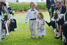 This flower girl's smile is contagious!  {Donna Von Bruening Photographers, Inc.}