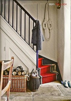 i think this is how my stairs will be positioned in the corner... i haven't thought about a railing... do I need one?  i do like the idea of maybe having some of the area under the stairs with doors on them... so not everything has to be neat!