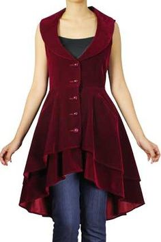 This pretty jacket is made from burgundy velvet. It is double skirted and has two hidden pockets at each side.