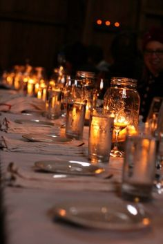 love just the mason jars with candles! could fill in around with small florals.