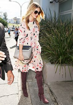Rosie Huntington-Whiteley goes boho in a floral dress and tall brown boots
