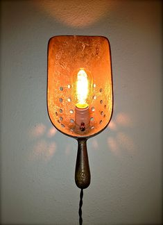 Rustic Steel Wall Sconce, Upcycled Light, Recycled Feed Scoop, Farm Tools, Exposed Bulb. $79.00, via Etsy.