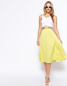 White crop top, yellow midi skirt, simple heeled sandals