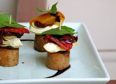 Turkey sausage, artichoke heart, roasted pepper, basil leaf. Garnish is balsamic reduction.