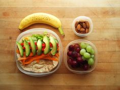 banana, whole wheat vegetable pita with romaine lettuce, carrot, cucumber, red bell pepper, avocado, salt and pepper, raw almonds, and green and red grapes.