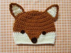 """Ooo, wouldn't this be a fantastic gift to put with other baby shower gifts?  This adorable baby fox hat makes a great baby shower gift that will be so different than what others will give the new mom to be.    Would also be the beginning of a really cool Halloween costume. :)    The """"Fox"""" hat...super adorable with 2 black button eyes and a black button nose.    Style: Beanie    Main Hat Color:  Rust ... 100% Soft Acrylic    2nd Color:  Cream ... 100% Soft Acrylic    Hand Crocheted by: Liz…"""