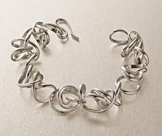 Twist Bracelet by Rina S. Young. Sterling silver is beautifully hand fabricated into delicate coils, joined together to create this dynamic bracelet. Also available in oxidized sterling silver.