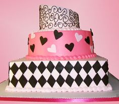 """Pretty, Pretty Pink!"" Party Cake. This 3-tier custom specialty cake will steal her breath away! The base of the cake is frosted in a light pink buttercream accented with a black fondant diamond harlequin pattern. The second tier is iced in a bright pink buttercream and is accented with black and light pink hearts. The top a light pink buttercream and is accented with black swirl scrolling. This cake is perfect for sweet sixteens, birthdays, and showers! Palermo's Bakery creates custom…"