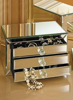 The perfect gift for your sister, mother, or best friend, the Large Mirrored Jewelry Box offers sophistication and organized storage for any vanity or dressing room.