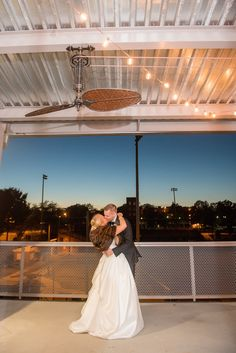 Mikkel Paige Photography photo of a wedding at The Rickhouse, NC. A picture of the bride and groom's outdoor, dusk/twilight last kiss of the night.