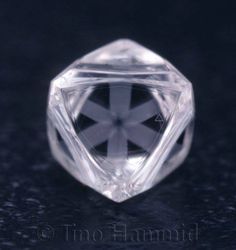 It's a natural diamond octahedron and nothing has been done to it.