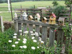 birdhouses on the fence - garden art ideas