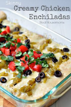 Skinny Creamy Chicken Enchiladas | Real Housemoms | I make two at a time and freeze one! So awesome.