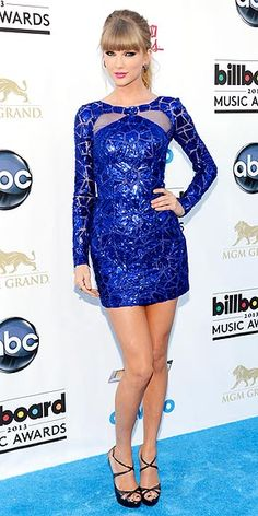 Photographed (in a Zuhair Murad mini dress and Jimmy Choo sandals) at the 2013 Billboard Music Awards in Las Vegas, Nevada, May 19, 2013