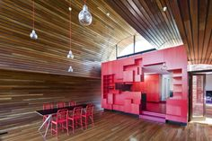Red kitchen in Cloud House, Melbourne, Australia