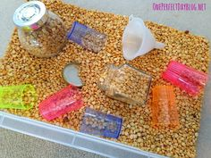 Play doesn't need to be complicated. The simplest activities are often the most engaging. Love this idea for fine motor skills, sensory play and lots of learning opportunities as well! I have the perfect time to try this out. Sensory Tubs, Sensory Boxes, Sensory Activities, Infant Activities, Sensory Play, Preschool Activities, Messy Play, Toddler Play, Fine Motor Skills