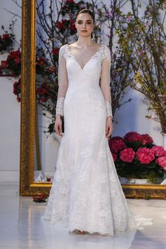 CHEYENNE - Blue Willow Bride by Anne Barge, Spring 2017 Collection. Wedding dress of Alencon lace with deep V neckline and long sleeves.