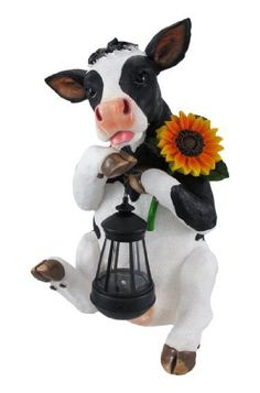 `Bright Bovine` Cow with Sunflower and Solar Lantern – Friendly Faces Cow Kitchen Decor, Cow Decor, Farmhouse Kitchen Decor, Solar Powered Lanterns, Holstein Cows, Sunflower Kitchen, Outdoor Statues, White Cow, Manualidades
