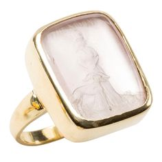 "This lovely quartz intaglio of the ancient Moon Goddess, Hecate, with her 3 headed dog and ""The Moon "" inscription is backed with a light pink Mother of Pearl piece.This ring casts a warm pink glow and is set in 18karat yellow polished gold. Ring size 7. #intaglio"