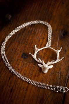 Gold Hanging Deer Necklace from Angel Court and Bourbon & Boots on Sale!