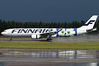 Finnair Airbus A330-302 OH-LTO aircraft, painted in ''Marimekko Unikko=a finnish home furnishings,textile & fashion company'' special colours Dec. 2014, landing at Finland Helsinki Vantaa International Airport. 31/07/2015.