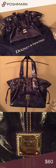 Navy patent leather Dooney Lg Chiarra bag Navy patent leather Dooney Lg Chiarra bag. This is my favorites style purse by Dooney & Bourke. Authentic all info shown in pics. This bag is gorgeous and has so much space and so many compartments. Pre-loved condition and small white streaks shown in the one pic and two corners starting to peel also seen in pics but using it don't really notice and anyone familiar with these Patent Leather bags this happens after a while. Tons of life left!! Dooney…