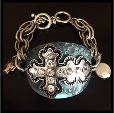 "Stunning bracelet with toggle. 2 charms, gold Cross and freshwater pearl. "" Would you take the place of this man. Would you take the nails from his hands""~Jerem"