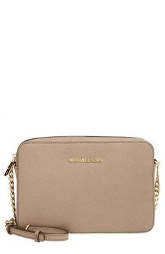 I love the pink color this bag comes in.... Michael Kors 'Large Jet Set' East/West Saffiano Crossbody Bag