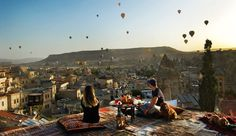 This is Goreme. Newly married couples and pets watch the hot air balloons in the morning and take off from the red rose valley. Terasta has created a very nice family table.