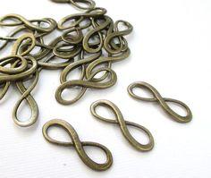 Brass Infinity Charm  Small Infinity Crossover by BijiBijoux