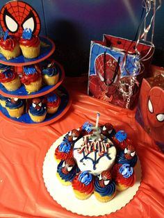Super hero party Found these SpiderMan Batman ring cupcakes at