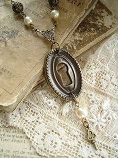 (oh i wish this wasnt so expensive...)UNLOCKED Keyhole Necklace. Antiqued Brass by RomantiquarianDesign, $78.50