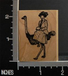 FUNNY WOMAN RIDING ON OSTRICH OR EMU CARRYING AN EGG RARE rubber stamp KEN BROWN